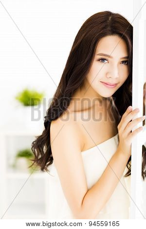 smiling young beautiful woman standing in living room