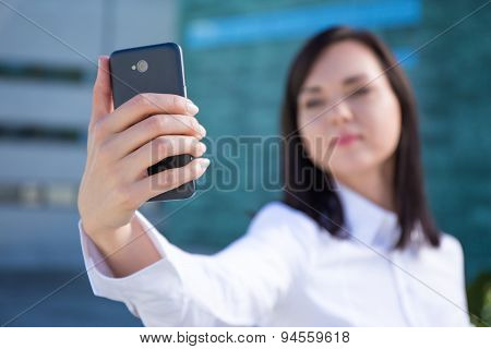 Smartphone In Beautiful Business Woman's Hand