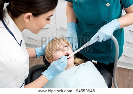 Dental Assistant Treat A Little Girl