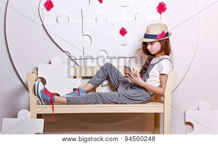 Trendy Teenage Girl With A Cell Phone.