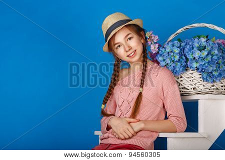 Pretty Teen Girl With A Basket Of Flowers.