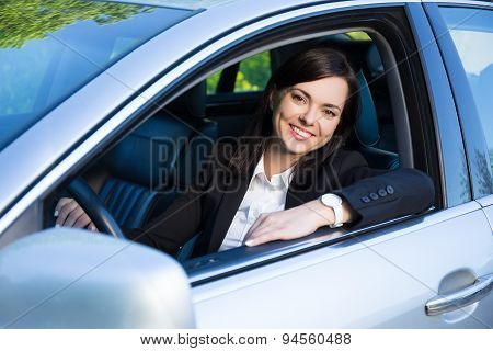 Young Business Woman Sitting In Her Car