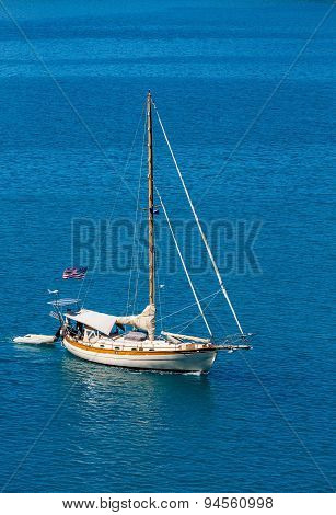 American Sailboat On Brilliant Blue Water