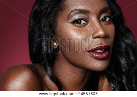 Closeup Portrait Of A Black Oman With Bright Lips