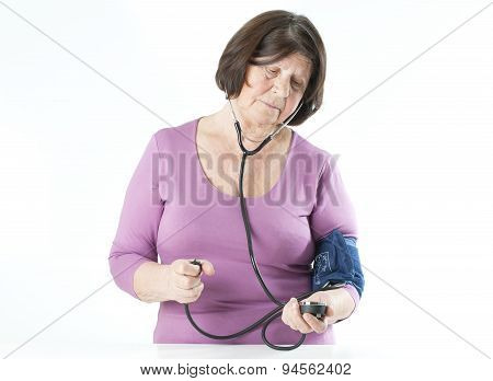 Elderly Woman Measuring Arterial Pressure.