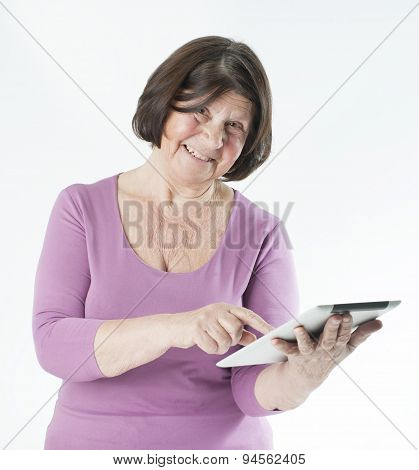 Elderly Woman With Tablet Computer.
