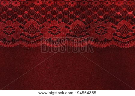 red lace on red velvet paper background