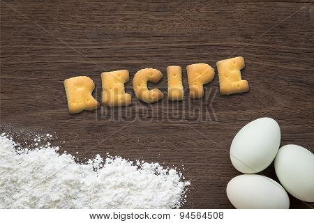 Alphabet Cookies Word Recipe On Cooking Table Background