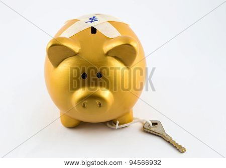 Piggy Bank In Gold Color Is Locked