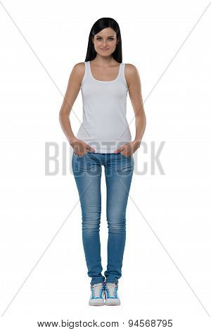 Full Length Of A Brunette Woman In A White Tank Top And Jeans. Isolated.