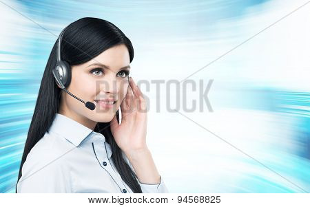 Portrait Of Smiling Cheerful Support Phone Operator In Headset. Modern Blue Background.