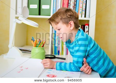 School Boy Doing Homework At Home