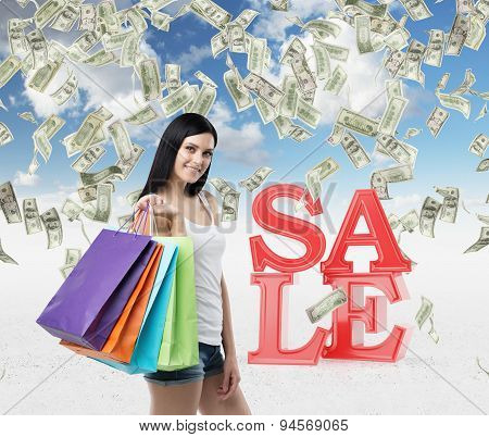Beautiful Smiling Brunette Woman With The Colourful Shopping Bags From The Fancy Shops. Falling Doll