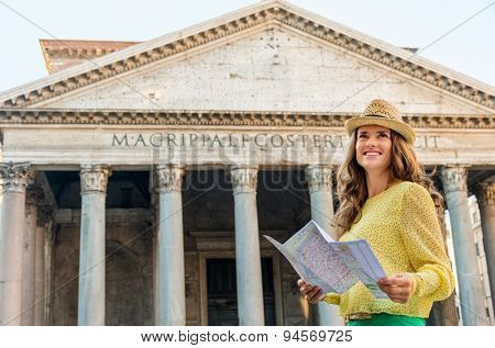 Happy Woman Standing By The Pantheon Holding Map In Rome