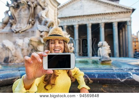 Closeup Of Woman's Hand Holding Mobile While Taking Selfie