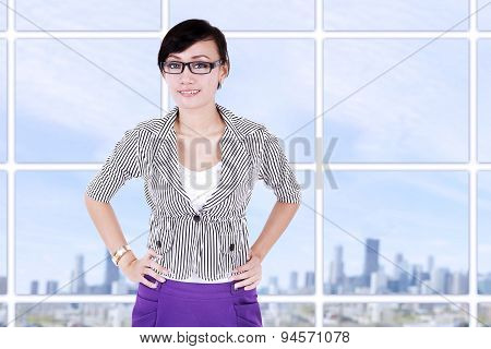 Smiling Businesswoman At Modern Office