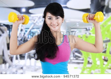 Slim Woman Workout With Dumbbells