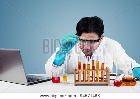 Serious Scientist Makes Experiment In Lab