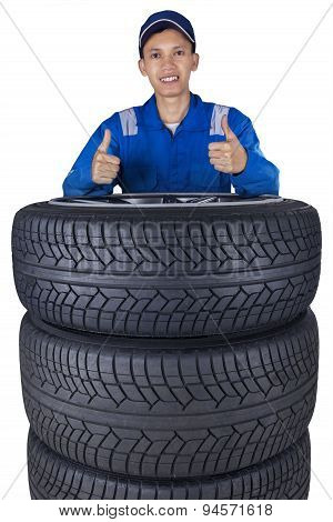 Technician With A Heap Of Tires