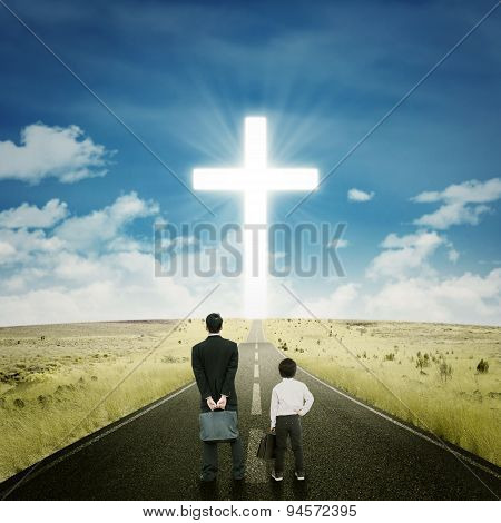 Two Businessmen On The Road With A Cross