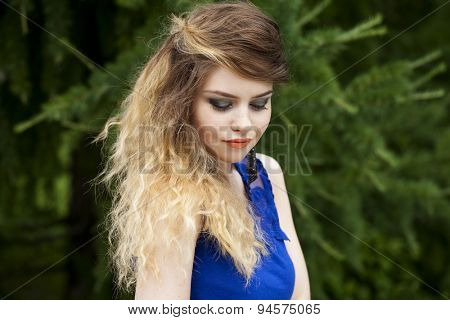 Close up Portrait, Young beautiful blonde woman posing outdoors in summer green park