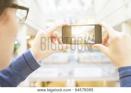 Man Photographs On The Phone