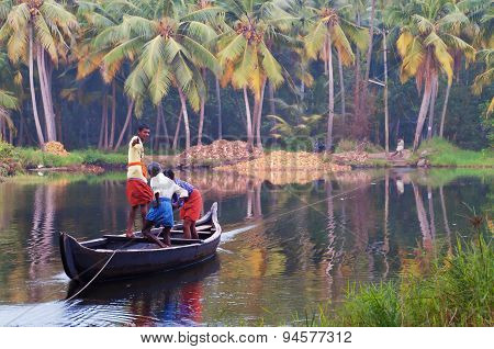 Indian Men In A Boat Across The River