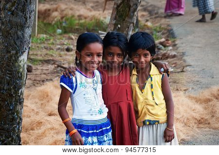 Three Indian Girls On The Street In Fishing Village