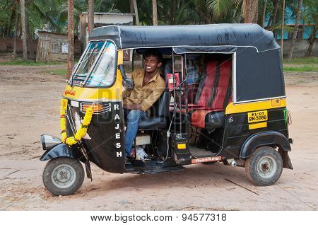 Indian Auto Rickshaw With Taxi Driver Man