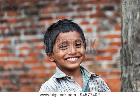 Portrait Of Indian Boy On The Street In Fishing Village