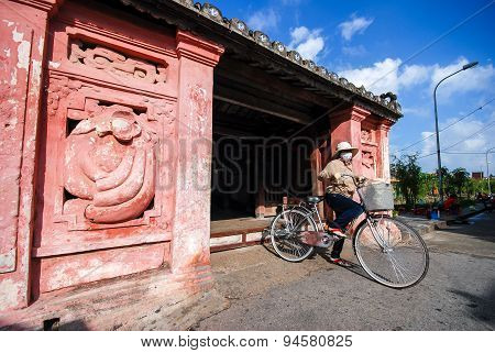 Woman Ride Bicycle At Japanese Bridge, Hoi An