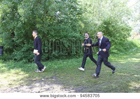 Three People Running In Their Business Suits