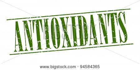 Antioxidants Green Grunge Vintage Stamp Isolated On White Background