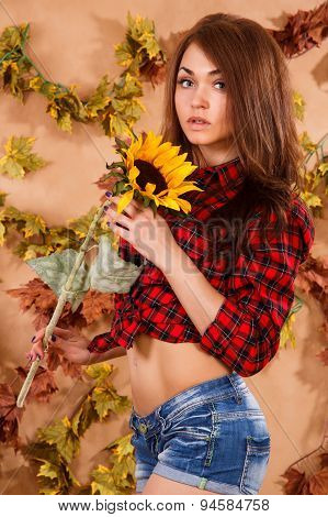 Cute Young Farmer Girl Holding The Sunflower