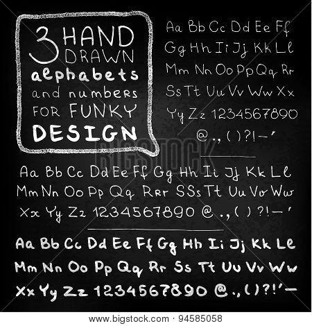 Hand three four fonts on blackboard