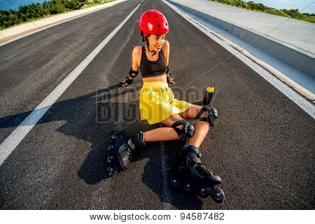 Sport woman with rollers on the highway