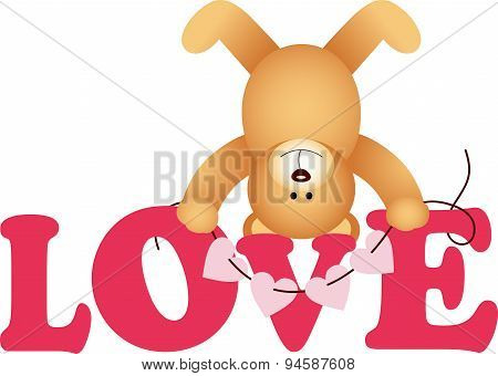 Word love with teddy bear
