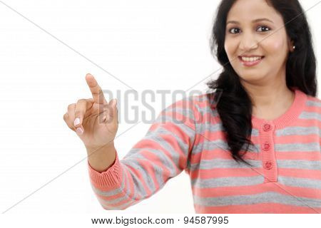 Smiling Young Woman Touching Imaginary Screen With Her Finger