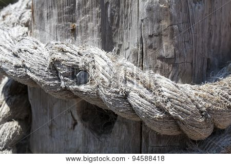Knotted Rope On A Fence Post