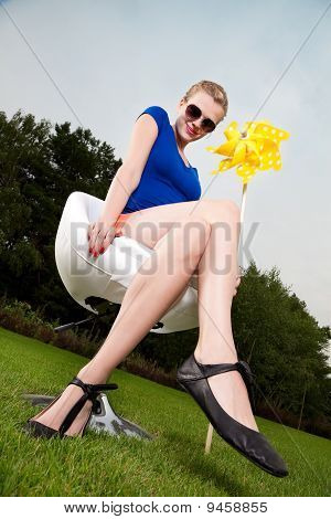 Blonde Girl With Sunglasses And A Pinwheel