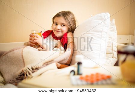 Girl Caught Flu And Drinking Hot Tea With Lemon In Bed