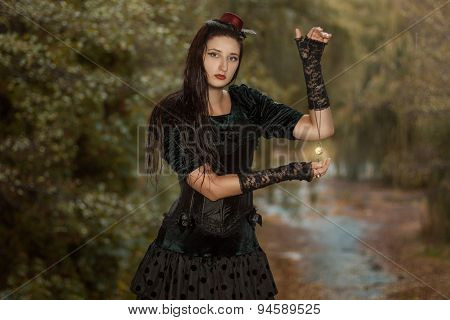 Girl Holding The Watch On A Chain