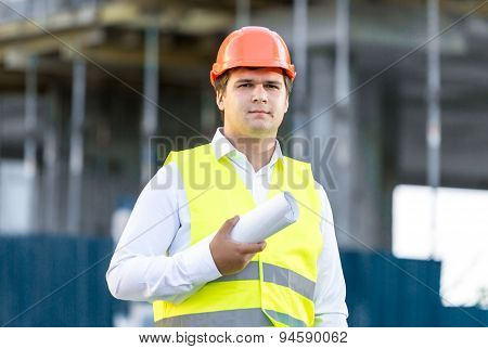 Portrait Of Construction Manager Posing Against Scaffolding