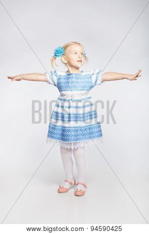 Little Girl Standing With Outstretched Arms