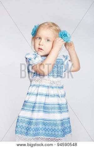 Little Girl Tying Her Hair In A Tail