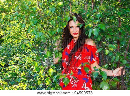 Young Woman In A Green Forest