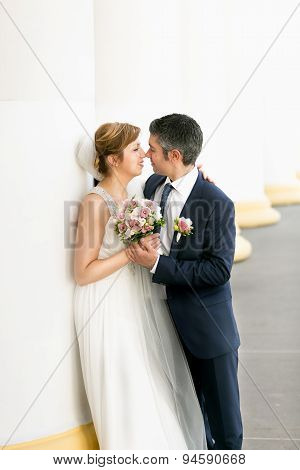 Romantic Newlyweds Looking At Each Other At Ancient Columns