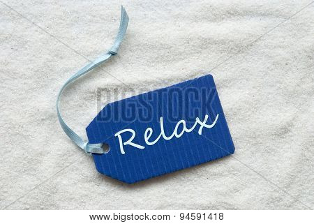 Relax On Blue Label Sand Background