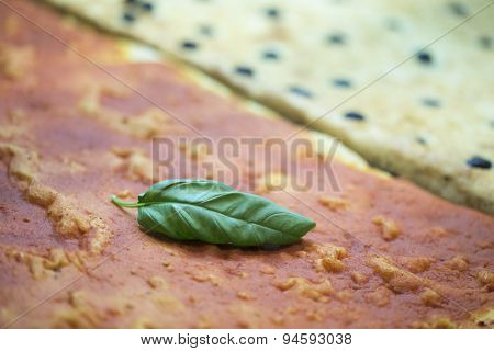 pizza with a leave of basil