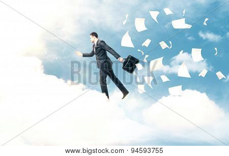 Businessman Jumping From Cloud